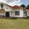 A BUNGALOW of 6 bedrooms ON SALE AT LUBOWA-ENTEBBE ROAD AT $500K
